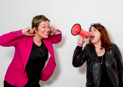 Sara and Nicky profile picture shouting into megaphone
